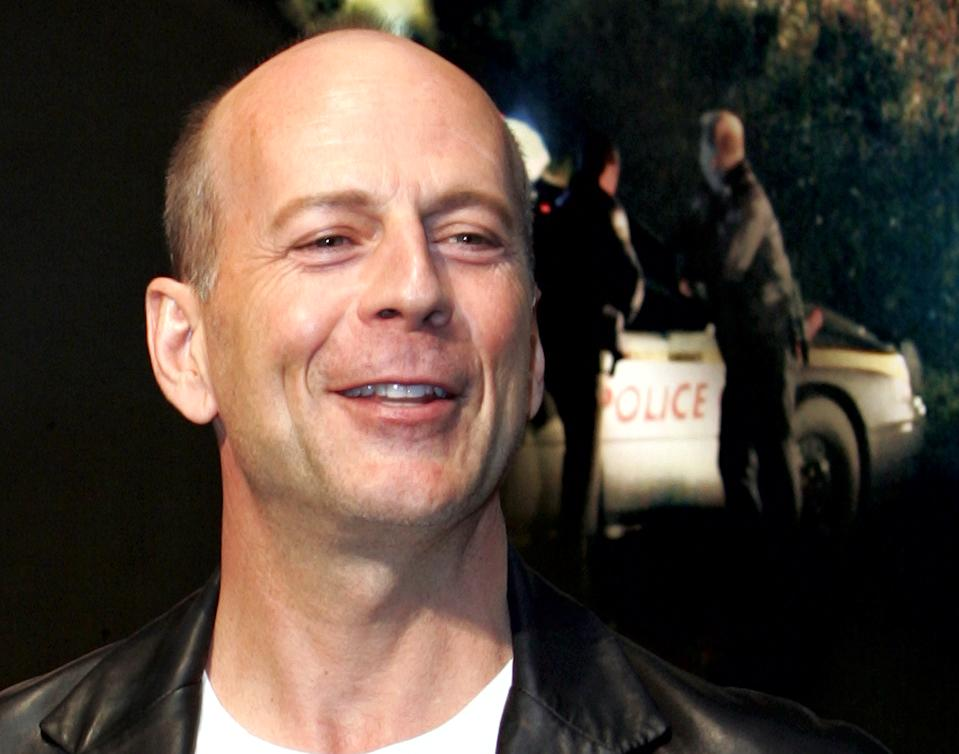 """U.S. actor Bruce Willis smiles during a news conference for his film """"Hostage"""" in Tokyo May 23, 2005. The action thriller film will open in Japan on June 4. REUTERS/Yuriko Nakao YN/TC"""