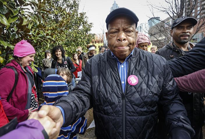 Rep. John Lewis reaches out to shake the hands of well-wishers as he arrives at the Women's March on Saturday, Jan. 21, 2017, in Atlanta. (Photo: Ron Harris/AP)