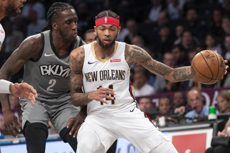 New Orleans Pelicans forward Brandon Ingram (14) drives against Brooklyn Nets forward Taurean Prince (2) during the first half of an NBA basketball game, Monday, Nov. 4, 2019, in New York. (AP Photo/Mary Altaffer)