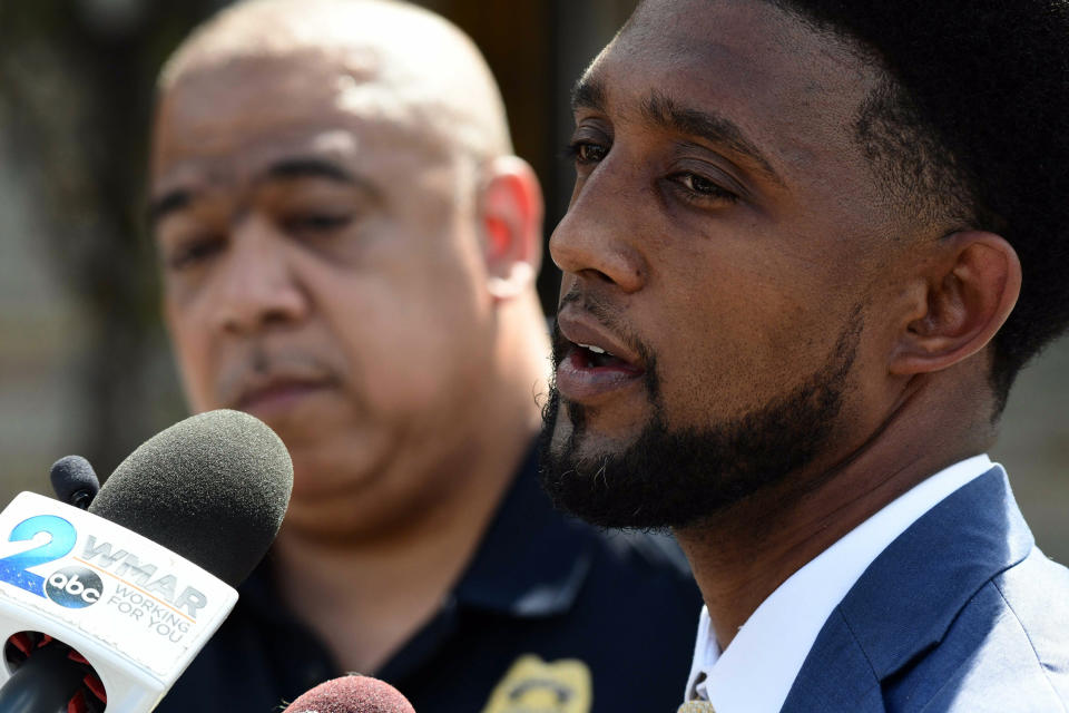 Baltimore Mayor Brandon Scott speak during a news conference as Police Commissioner Michael Harrison, left, listens, Wednesday, June 16, 2021, in Baltimore. One person was killed and five others were wounded Wednesday when gunmen walked up a street and opened fire on a Baltimore block from an intersection, the city's police commissioner said. (Kim Hairston/The Baltimore Sun via AP)