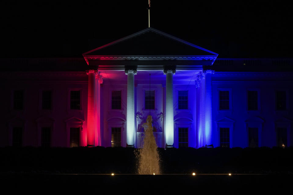 The White House is lit red, white and blue on Friday, July 23, 2021, in Washington for the the 2020 Summer Olympics in Japan. (AP Photo/Andrew Harnik)