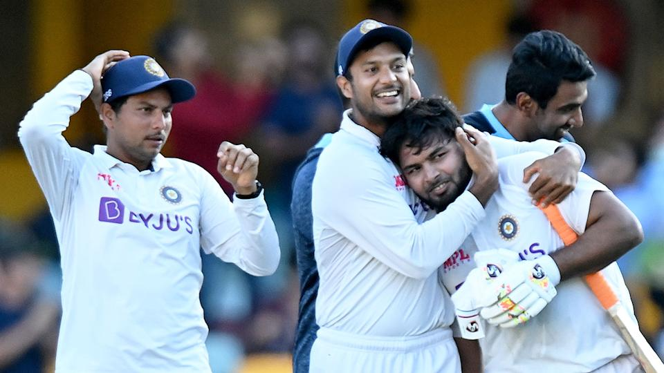 Rishabh Pant is seen here being hugged by an Indian teammate at the Gabba.