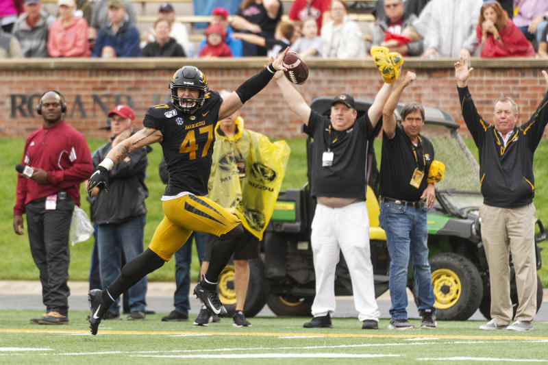 Missouri linebacker Cale Garrett runs to the end zone after an interception during the second quarter of an NCAA college football game against Troy Saturday, Oct. 5, 2019, in Columbia, Mo. (AP Photo/L.G. Patterson)