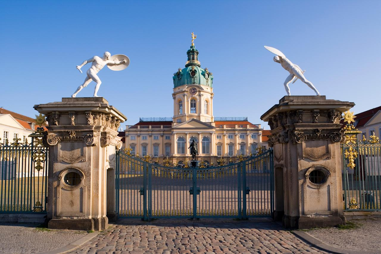 """<p><strong>Tell me: What's this place all about?</strong> A dose of Baroque beauty in a city known for its grit, this castle and manicured gardens are a stately reminder of Berlin's proud Prussian past. Known as """"Berlin's Versailles,"""" Schloss Charlottenburg (literally: Charlottenburg Palace) started as a breezy summer retreat for King Friedrich's wife; by 1790, it had expanded into a sprawling royal playground, complete with idyllic walking paths, a carp pond, and three smaller structures scattered around the gold-colored main palace. Today, the ground's ensemble of rococo buildings each charge an admission fee, but the tranquil gardens are free to explore.</p> <p><strong>What's it like being there?</strong> As you push past the heavy iron gates separating modern-day Berlin from Friedrich the Great's Court of Honor courtyard, you'll be transported back to an 18th-century world of opulence. The Altes Schloss, the main part of the main building, is where Friedrich and his wife lived in a blur of extravagant tapestry, furniture, and imported china. If lavish porcelain leaves you cold, make your way to the Neuer Flügel (New Building), home to one of the largest collections of French paintings outside of France. But regardless of your taste and budget, it's hard not to be transported to Zen-like bliss as you walk, sunbathe, or lay down amid the vast Italianate gardens and splashing fountains.</p> <p><strong>Is there a guide involved?</strong> The Old Palace's and New Building's admission fees both include an audio guide. You can also sign up for a guided tour, which run hourly from the Old Palace and take in the Oak Gallery, home of the royal portraits.</p> <p><strong>Did it meet expectations?</strong> Schloss Charlottenburg's richly appointed period furniture will likely appeal to those with a taste for the finer things in life, but for our money (and time), the site's main attraction is its free and extravagantly maintained gardens. Few European capitals boast as large"""