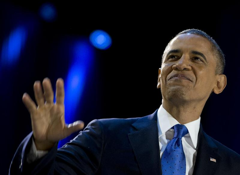 FILE - This Nov. 7, 2012 file photo shows President Barack Obama looks the the cheering crowd at the election night party at McCormick Place in Chicago. Presidential terms are measured by sweeping laws and stirring events, but legacies are about enduring ideas. The one Barack Obama has in mind will drive most everything he tries to do in the next four years: assuring that America is a place where anyone can make it. (AP Photo/Carolyn Kaster, File)