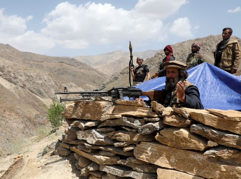 FILE PHOTO: Armed men who are against Taliban uprising stand at their check post, at the Ghorband District