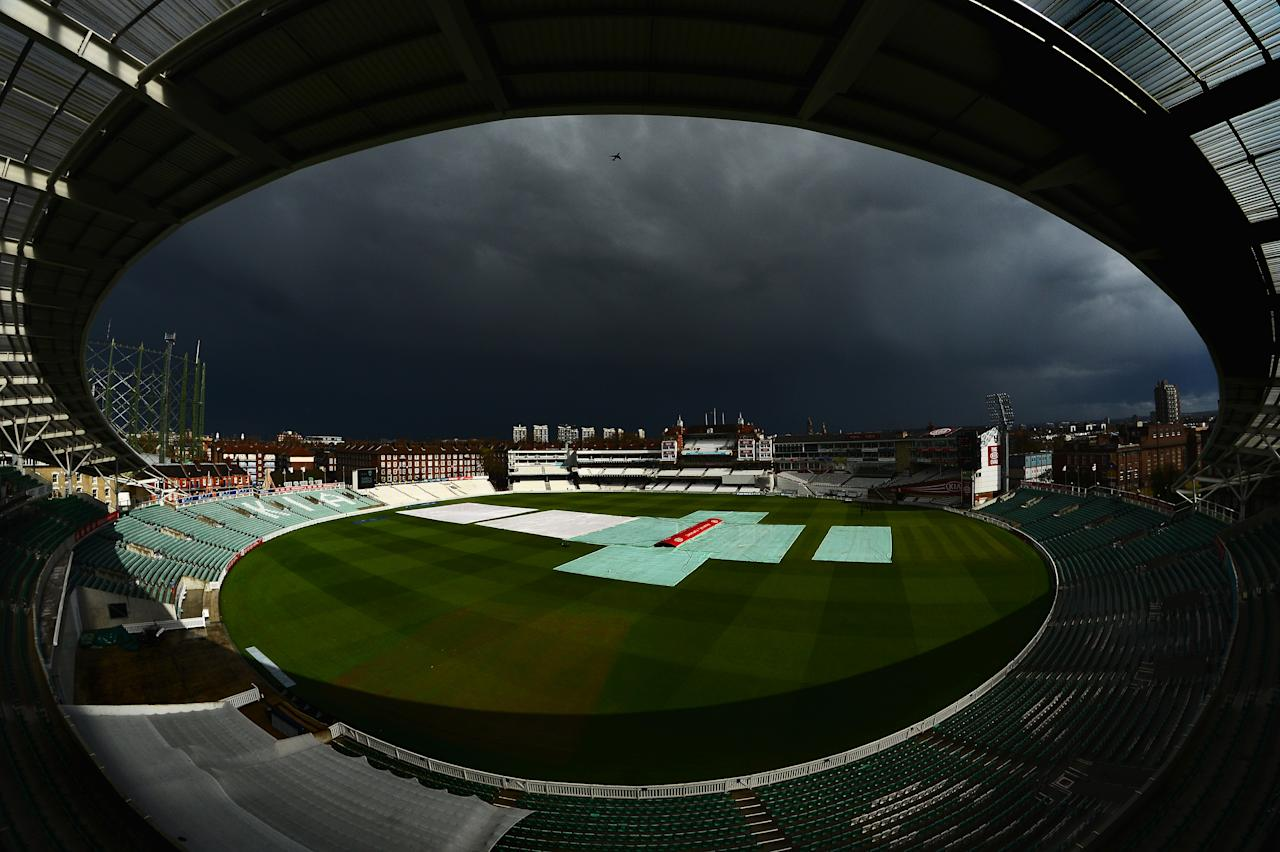 LONDON, ENGLAND - APRIL 18:  Storm clouds fill the sky over the Oval during day two of the LV County Championship Division One match between Surrey and Somerset at The Kia Oval on April 18, 2013 in London, England. (Photo by Mike Hewitt/Getty Images)