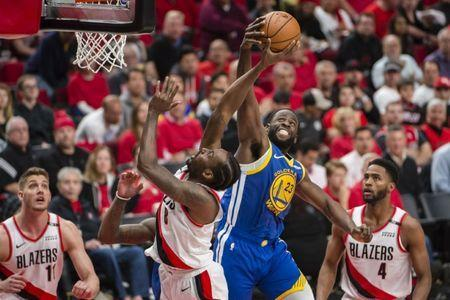 May 20, 2019; Portland, OR, USA; Golden State Warriors forward Draymond Green (23) blocks a shot by Portland Trail Blazers forward Al-Farouq Aminu (8) during the second half in game four of the Western conference finals of the 2019 NBA Playoffs at Moda Center. The Warriors won 119-117 in overtime. Mandatory Credit: Troy Wayrynen-USA TODAY Sports