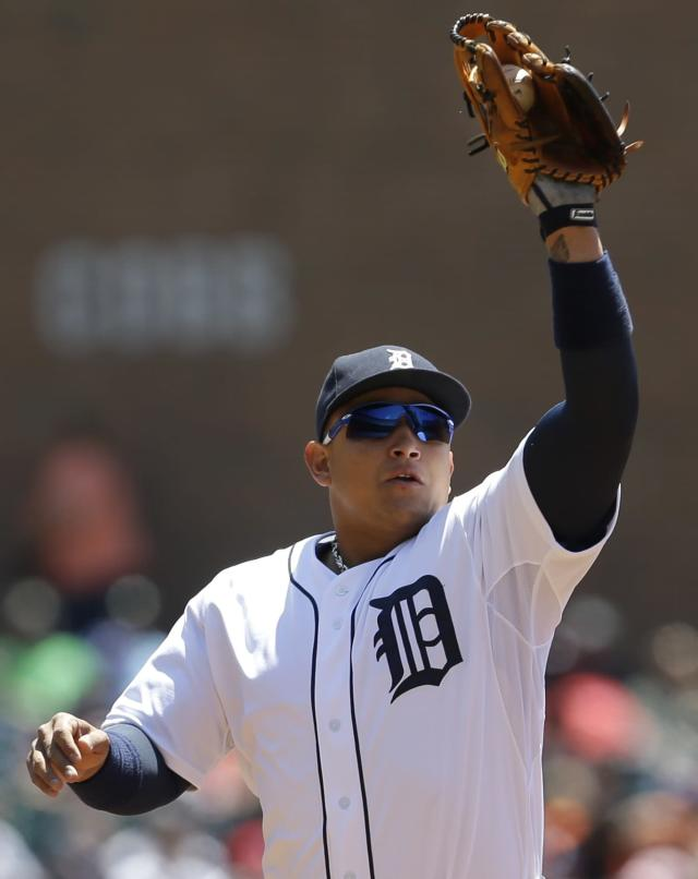 Detroit Tigers third baseman Miguel Cabrera catches a Baltimore Orioles' Nick Markakis ground ball before throwing him out in the first inning of a baseball game in Detroit, Wednesday, June 19, 2013. (AP Photo/Paul Sancya)