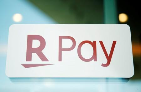 The logo of Rakuten Pay, QR code mobile payment system operated by Rakuten, is displayed at a coffee shop in Tokyo
