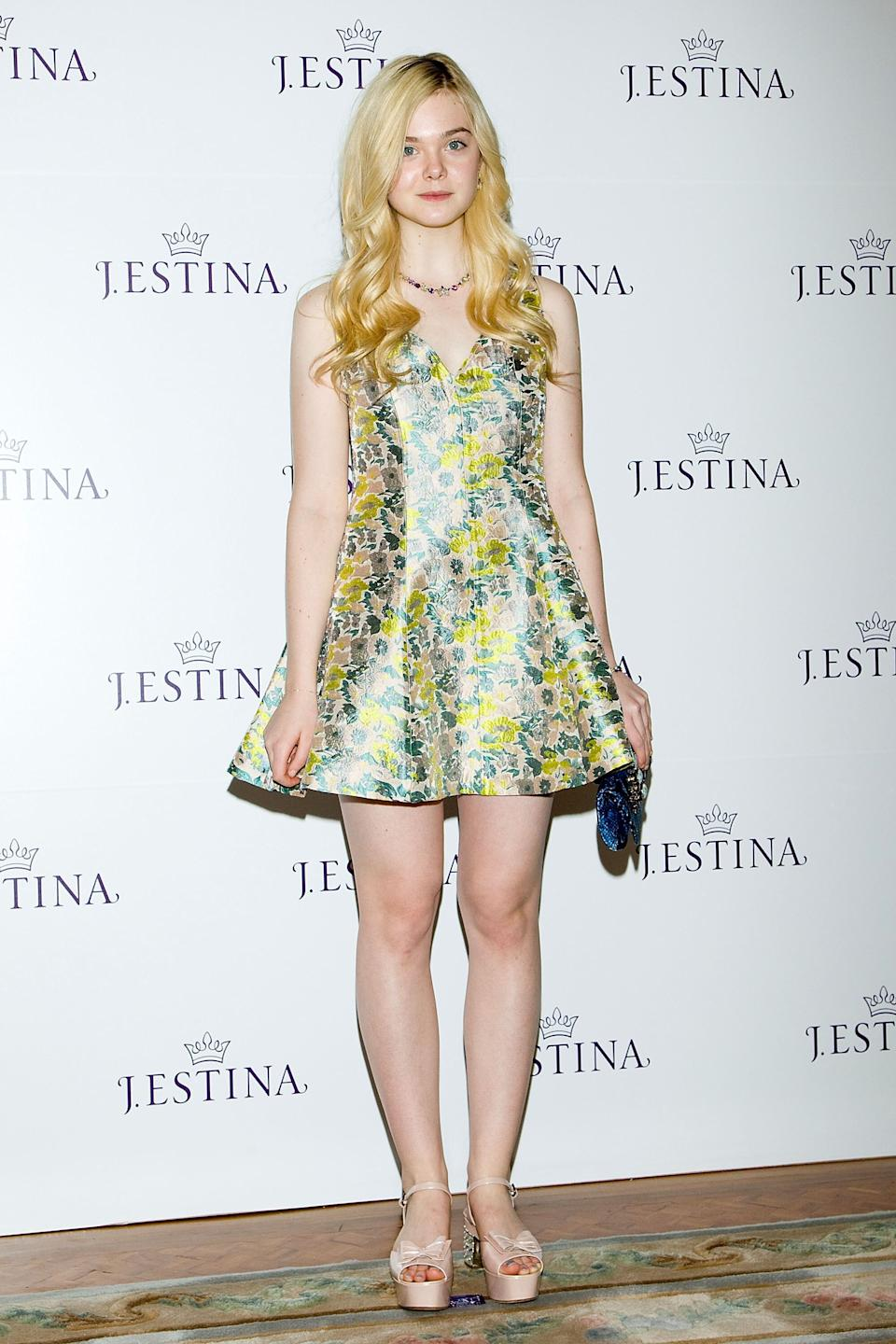 Fanning at a promotional event for the 2013 J.ESTINA SS presentation at Shilla Hotel in Seoul, South Korea.