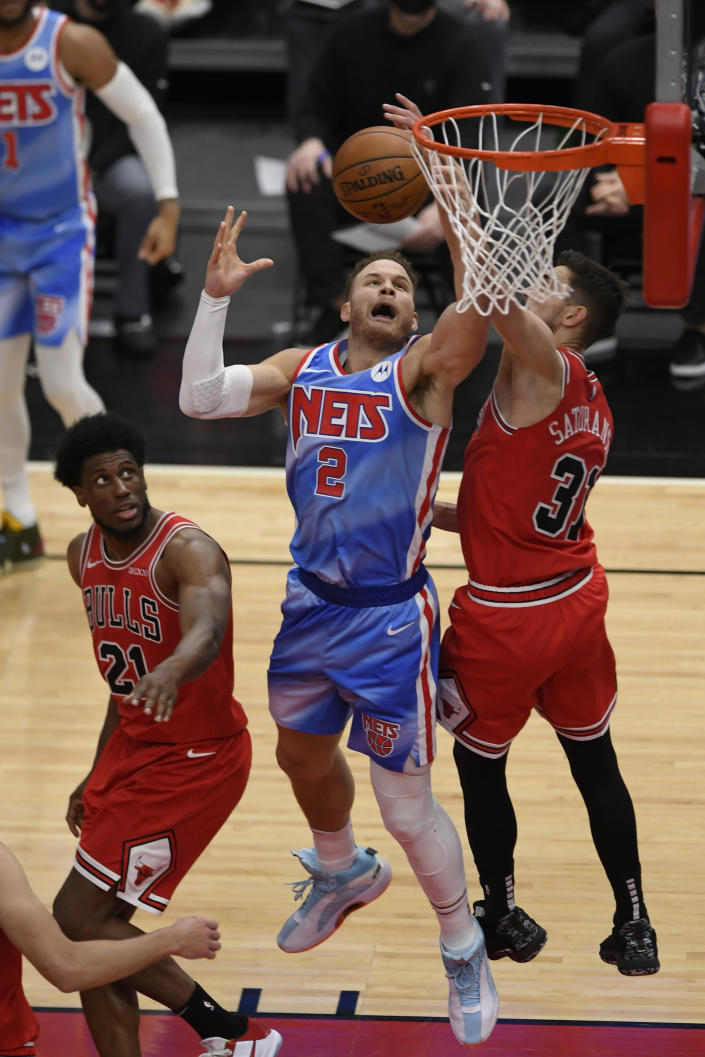Brooklyn Nets' Blake Griffin (2) goes up for a rebound against Chicago Bulls' Thaddeus Young (21) and Tomas Satoransky (31) of The Czech Republic during the second half of an NBA basketball game Sunday, April 4, 2021, in Chicago. (AP Photo/Paul Beaty)