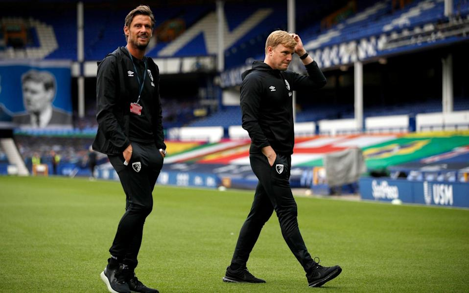 Bournemouth manager Eddie Howe (right) and assistant manager Jason Tindall walk the pitch prior to the Premier League match - PA