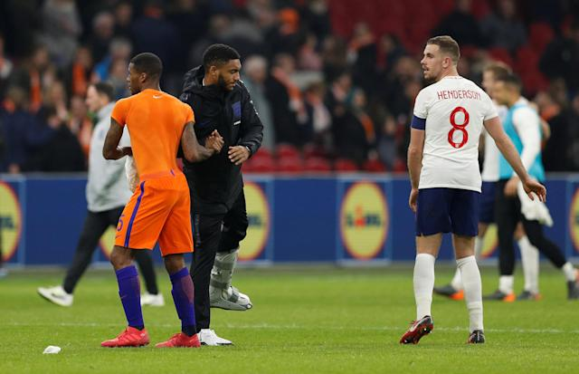 Soccer Football - International Friendly - Netherlands vs England - Johan Cruijff Arena, Amsterdam, Netherlands - March 23, 2018 England's Jordan Henderson and Joe Gomez with Netherlands' Georginio Wijnaldum after the match Action Images via Reuters/John Sibley