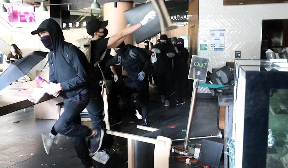 Anti-government protesters ransack a Starbucks coffee shop at the Hong Kong University of Science and Technology. Photo: Dickson Lee