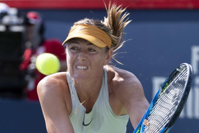 Maria Sharapova, of Russia returns to Sesil Karatantcheva, of Bulgaria, during the Rogers Cup women's tennis tournament, Tuesday, Aug. 7, 2018, in Montreal. (Paul Chiasson/The Canadian Press via AP)