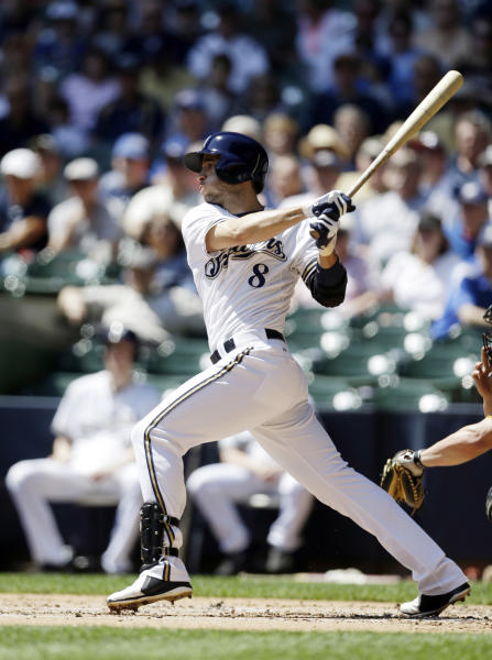 Milwaukee Brewers' Ryan Braun hits an RBI single against the Pittsburgh Pirates during the first inning of a baseball game Wednesday, May 1, 2013, in Milwaukee. (AP Photo/Jeffrey Phelps)