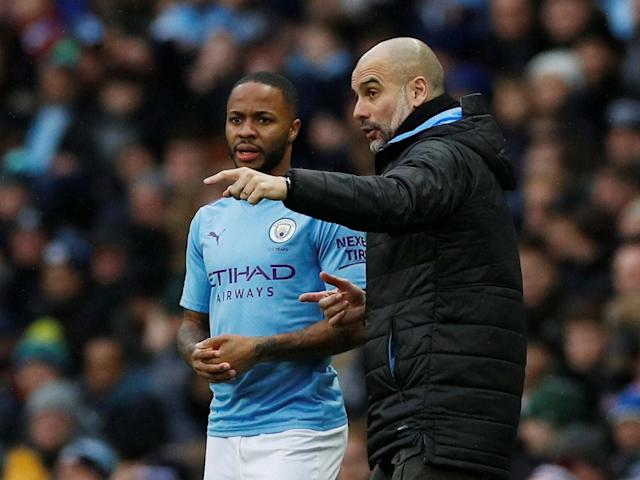 Manchester City's Raheem Sterling receives instructions from manager Pep Guardiola: REUTERS