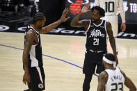 Los Angeles Clippers guard Patrick Beverley, right, celebrates with forward Kawhi Leonard during the second half of the team's NBA basketball game against the Utah Jazz in Los Angeles, Friday, Feb. 19, 2021. (AP Photo/Kelvin Kuo)