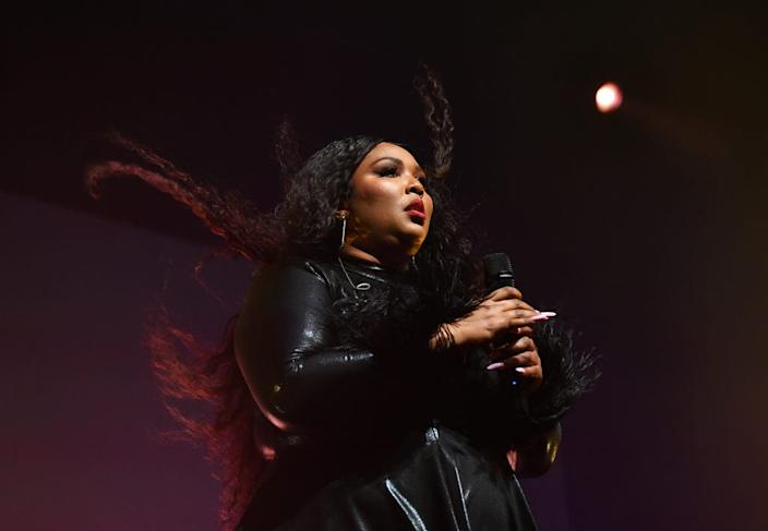 """Lizzo performs onstage during Spotify Hosts """"Best New Artist"""" Party at The Lot Studios on January 23, 2020, in Los Angeles."""