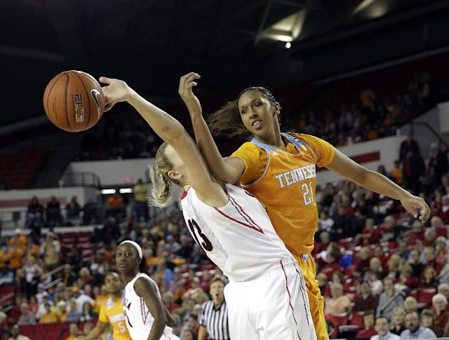 Tennessee center Mercedes Russell (21) and Georgia forward Merritt Hempe (13) fight for a rebound in the first half of an NCAA women's college basketball game, Sunday, Jan. 5, 2014, in Athens, Ga. (AP Photo/John Bazemore)