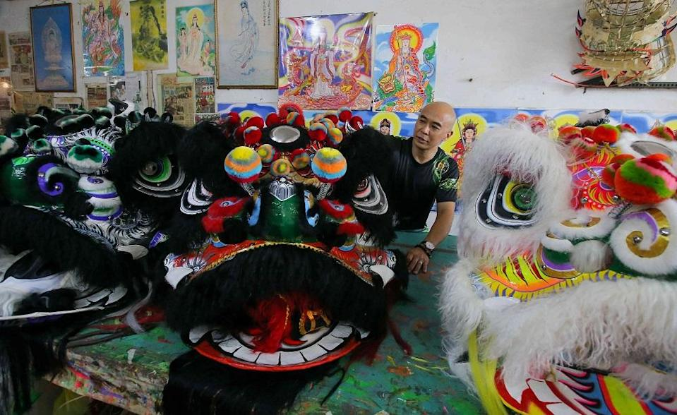 Teh Wing Liang started making lion and dragon heads in after completing his secondary education in 1994. ― Pictures by Farhan Najib