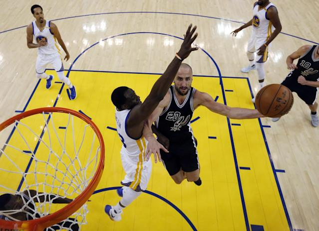 <p>San Antonio Spurs' Manu Ginobili (20) drives to the basket as Golden State Warriors' Draymond Green, center left, defends during the first half of Game 2 of the NBA basketball Western Conference finals, Tuesday, May 16, 2017, in Oakland, Calif. (AP Photo/Marcio Jose Sanchez) </p>