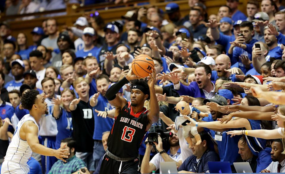 DURHAM, NC - DECEMBER 05: Keith Braxton #13 of the St. Francis (Pa) Red Flash tries to throw the ball in against Gary Trent Jr #2 of the Duke Blue Devils during their game at Cameron Indoor Stadium on December 5, 2017 in Durham, North Carolina.