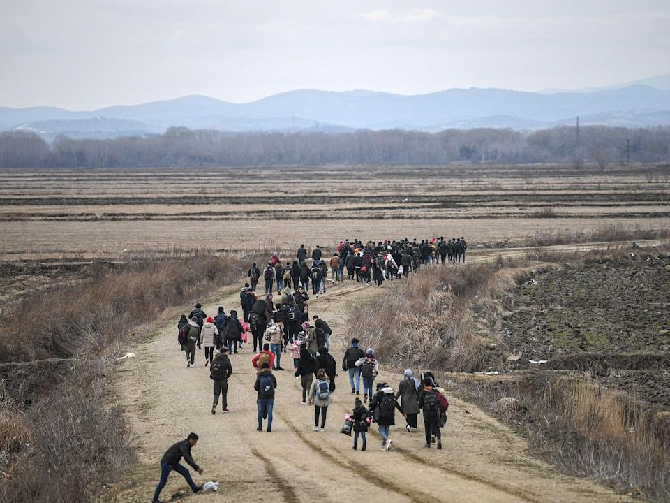 Refugees travelling across Europe (AFP)