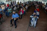 Elderly people wait after receiving doses of the AstraZeneca vaccine in Mexico City
