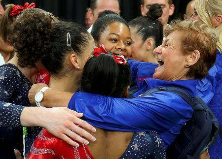 FILE PHOTO: Team Coordinator Marta Karolyi (R) hugs Gabby Douglas, Aly Raisman, Laurie Hernandez, Simone Biles and Madison Kocian of USA during the women's qualifications at the 2016 Rio Olympics in Rio de Janeiro, Brazil, August 7, 2016. REUTERS/Mike Blake/File Photo