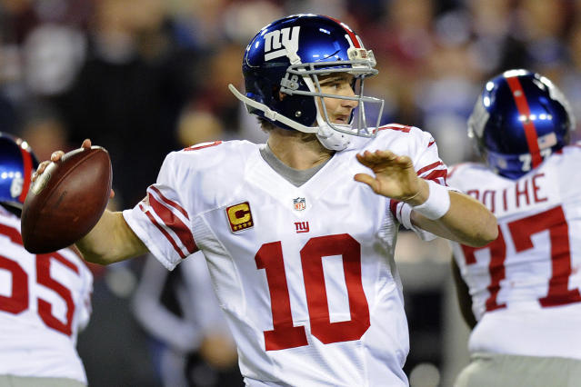 New York Giants quarterback Eli Manning (10) passes the ball during the first half of an NFL football game against the Washington Redskins in Landover, Md., Monday, Dec. 3, 2012. (AP Photo/Nick Wass)