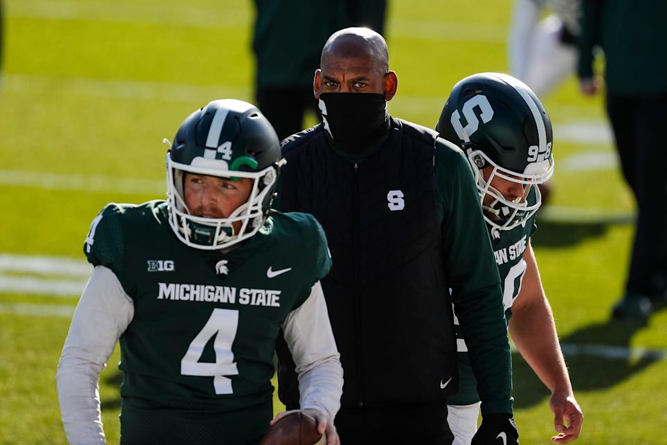 Michigan State head coach Mel Tucker watches warm up ahead of the Indiana game at Spartan Stadium in East Lansing, Saturday, Nov. 14, 2020.