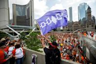 A man waves the Haudenosaunee flag at Toronto City Hall during a march on July 1, 2021