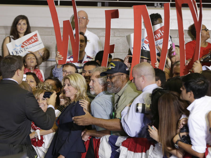Sen. Wendy Davis, D-Fort Worth, poses for photos with supporters after a rally Thursday, Oct. 3, 2013, in Haltom City, Texas. Davis formally announced her campaign to run for Texas governor. (AP Photo/LM Otero)