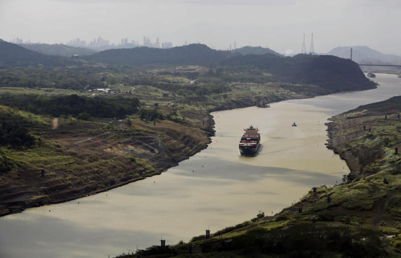 FILE - This March 23, 2015 file photo shows a cargo ship sailing through the Culebra Cut, during a media tour organized by Salini Impregilo, sub-contractor of the canal expansion project in Panama City, Panama. In 1903, the U.S. engineered Panamanian independence from Colombia and gained sovereign rights over the zone where the Panama Canal would connect Atlantic and Pacific shipping routes. (AP Photo/Arnulfo Franco, File)