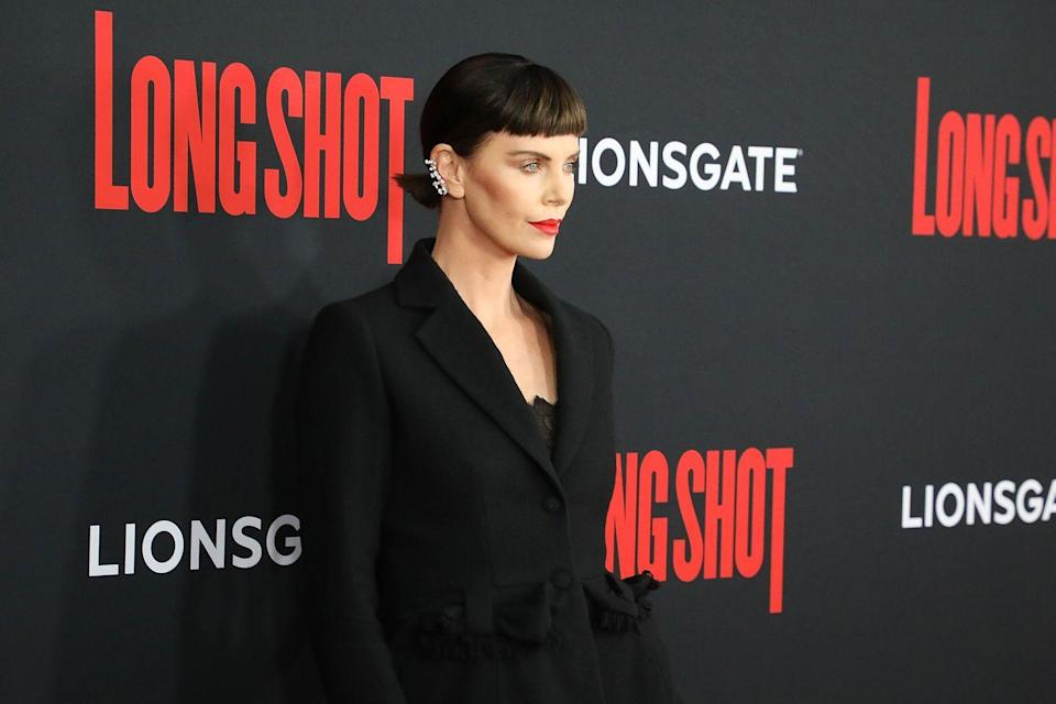 <p>We'll never get over Charlize Theron's switch to the dark side by way of this new(ish) inky, brunette shade. It could be this masterful contouring, but something about her micro-fringe and spikey ponytail makes her naturally round face look so sculpted. </p>