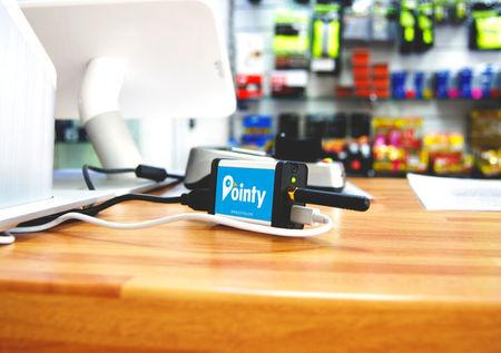 FILE PHOTO: A device developed by Pointy is seen in use in an undated picture handed out by the company, in Dublin, Ireland. Pointy handout via REUTERS