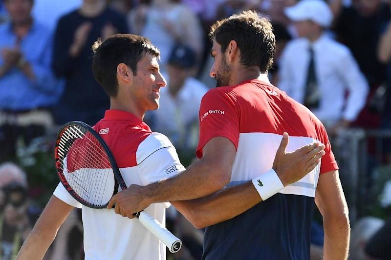 Well done: Marin Cilic  embraces Novak Djokovic after winning the Queen's title