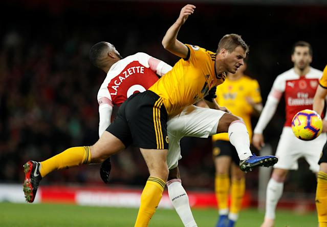 """Soccer Football - Premier League - Arsenal v Wolverhampton Wanderers - Emirates Stadium, London, Britain - November 11, 2018 Arsenal's Alexandre Lacazette in action with Wolverhampton Wanderers' Ryan Bennett Action Images via Reuters/John Sibley EDITORIAL USE ONLY. No use with unauthorized audio, video, data, fixture lists, club/league logos or """"live"""" services. Online in-match use limited to 75 images, no video emulation. No use in betting, games or single club/league/player publications. Please contact your account representative for further details."""