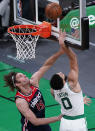 Boston Celtics forward Jayson Tatum (0) drives to the basket past Washington Wizards center Robin Lopez (15) during the first half of an NBA basketball Eastern Conference Play-in game, Tuesday, May 18, 2021, in Boston. (AP Photo/Charles Krupa)