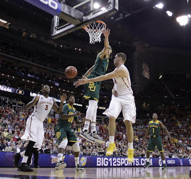 Iowa State's Georges Niang, right, passes around Baylor's Isaiah Austin during the first half of an NCAA college basketball game in the Big 12 men's tournament final, Saturday, March 15, 2014, in Kansas City, Mo. (AP Photo/Charlie Riedel)