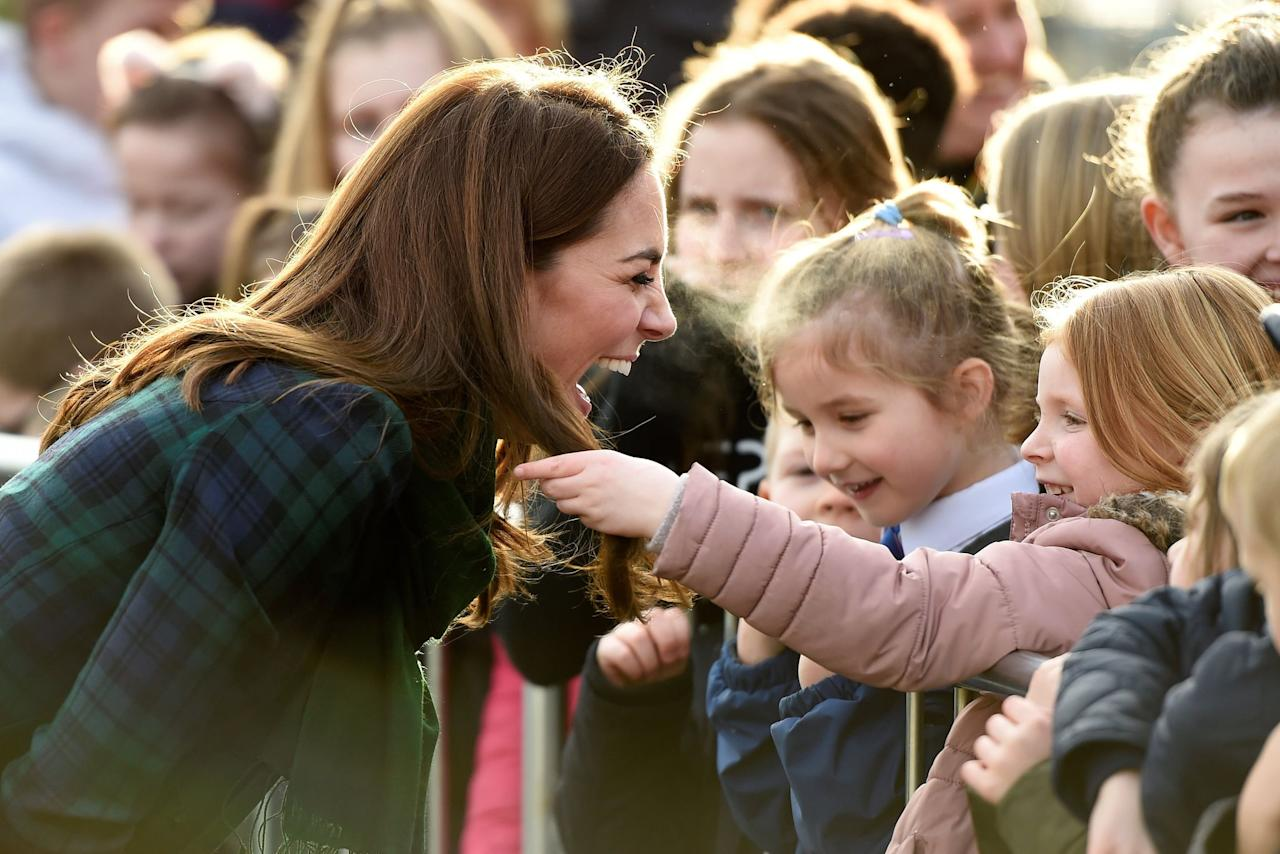 <p>Kate laughed as a little girl touched her famous blowout during a visit to Dundee, Scotland in January 2019.</p>