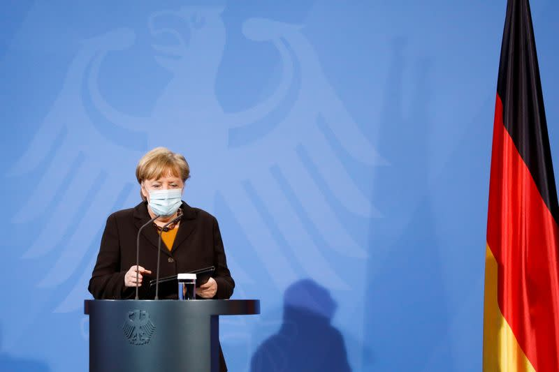 FILE PHOTO: German Chancellor Angela Merkel arrives for a news conference after a virtual meeting with federal state governors at the chancellery in Berlin