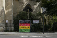 A Grenfell Tower sign is attached to a church, in the area of Notting Hill, in London, Monday, Aug. 31, 2020. Today would there have been the main parade of the iconic Notting Hill Carnival, cancelled due to the coronavirus outbreak. It will take place with live streaming performances. (AP Photo/Alberto Pezzali)