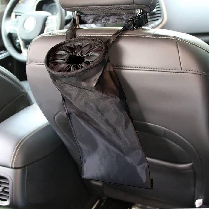 """Hook this to the back of the seat in your car, and it's sure to save the day (and your upholstery) from suckers, soda bottles and all the other sticky substances your kids sneak into the car.<br /><br /><strong>Promising review:</strong>""""This is the most useful little item I have EVER placed in my car for litter management. It's easy to use, easy to empty, AND it doubles as a spare cup holder when needed. I've ordered more for our other cars.<strong>The kids have really improved their management of basic tidiness in the car with this in our family vehicle.</strong>My husband has managed to keep the passenger seat easy for me to join him in his car, and<strong>now our teens will enjoy an uncluttered life in the 'teen mobile.'</strong>"""" — <a href=""""https://www.amazon.com/gp/customer-reviews/R1NKSZ1Z7C9FJ4?&linkCode=ll2&tag=huffpost-bfsyndication-20&linkId=7320f2e7c2b11645a2ddc811efc1da1d&language=en_US&ref_=as_li_ss_tl"""" target=""""_blank"""" rel=""""nofollow noopener noreferrer"""" data-skimlinks-tracking=""""5750537"""" data-vars-affiliate=""""Amazon"""" data-vars-href=""""https://www.amazon.com/gp/customer-reviews/R1NKSZ1Z7C9FJ4?tag=bfmal-20&ascsubtag=5750537%2C3%2C33%2Cmobile_web%2C0%2C0%2C0"""" data-vars-keywords=""""cleaning"""" data-vars-link-id=""""0"""" data-vars-price="""""""" data-vars-retailers=""""Amazon"""">DW</a><br /><br /><strong>Get it from Amazon for<a href=""""https://www.amazon.com/dp/B01L5E7OB2?_encoding=UTF8&psc=1&linkCode=ll1&tag=huffpost-bfsyndication-20&linkId=dd4efc8aab04f0dfcf66f60fbdbdace4&language=en_US&ref_=as_li_ss_tl"""" target=""""_blank"""" rel=""""nofollow noopener noreferrer"""" data-skimlinks-tracking=""""5750537"""" data-vars-affiliate=""""Amazon"""" data-vars-asin=""""B01L5E7OB2"""" data-vars-href=""""https://www.amazon.com/dp/B01L5E7OB2?tag=bfmal-20&ascsubtag=5750537%2C3%2C33%2Cmobile_web%2C0%2C0%2C16107952"""" data-vars-keywords=""""cleaning"""" data-vars-link-id=""""16107952"""" data-vars-price="""""""" data-vars-product-id=""""17880049"""" data-vars-product-img=""""https://m.media-amazon.com/images/I/51poRQJmfRL._SL500_.jpg"""" data-vars-product-titl"""