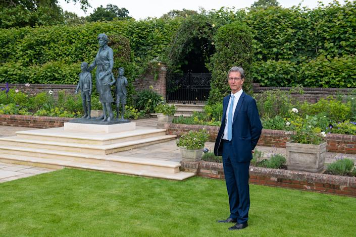 LONDON, ENGLAND - JULY 01: Sculptor, Ian Rank-Broadley poses with his Diana, Princess of Wales statue in the Sunken Garden at Kensington Palace, following the unveiling on July 1, 2021 in London, England. Today would have been the 60th birthday of Princess Diana, who died in 1997. At a ceremony here today, her sons Prince William, Duke of Cambridge and Prince Harry, Duke of Sussex unveiled a statue in her memory. (Photo by Dominic Lipinski - WPA Pool/Getty Images)