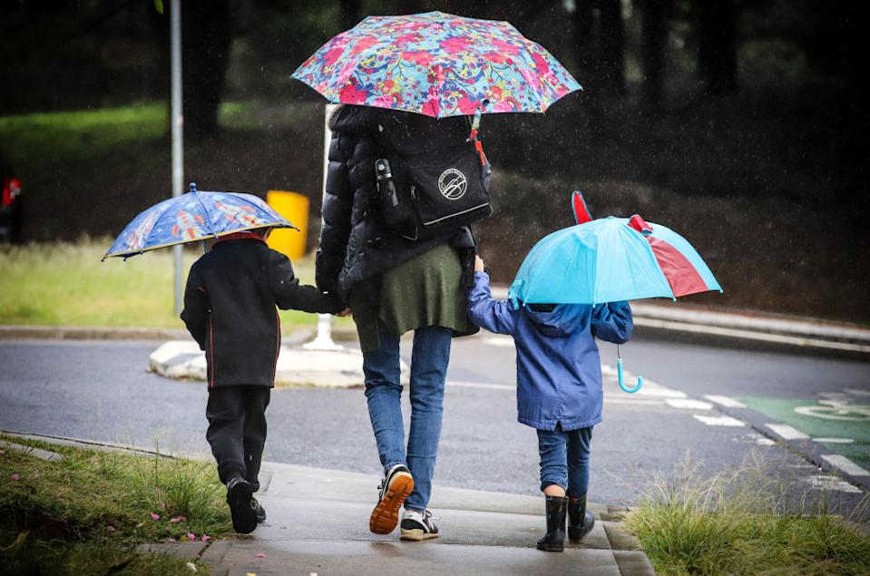 A mum walks her two children to school in Sydney after NSW's first lockdown ended. Source: Getty