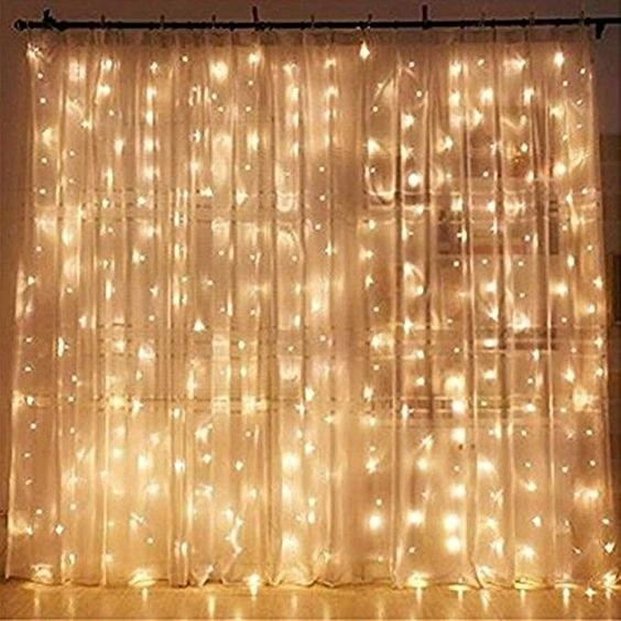 """Make your room look extra cozy and magical with these dangling fairy lights. $18, Amazon. <a href=""""https://www.amazon.com/Twinkle-Window-Curtain-String-Light/dp/B01LLSNG1E/"""">Get it now!</a>"""