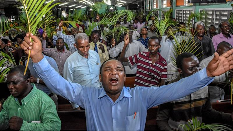 Believers pray without taking social distancing during a Palm Sunday mass at the Full Gospel Bible Fellowship Church in Dar es Salaam, Tanzania, on April 5, 2020.